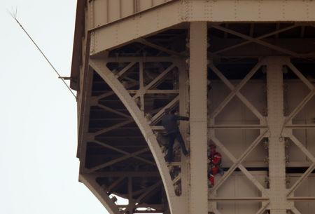 Intruder climbs side of Eiffel Tower, forcing evacuations
