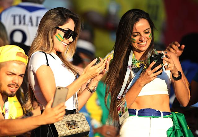 <p>Aine Coutinho(L) the wife of Philippe Coutinho of Brazil is seen during the 2018 FIFA World Cup Russia group E match between Serbia and Brazil at Spartak Stadium on June 27, 2018 in Moscow, Russia. (Photo by Ian MacNicol/Getty Images) </p>