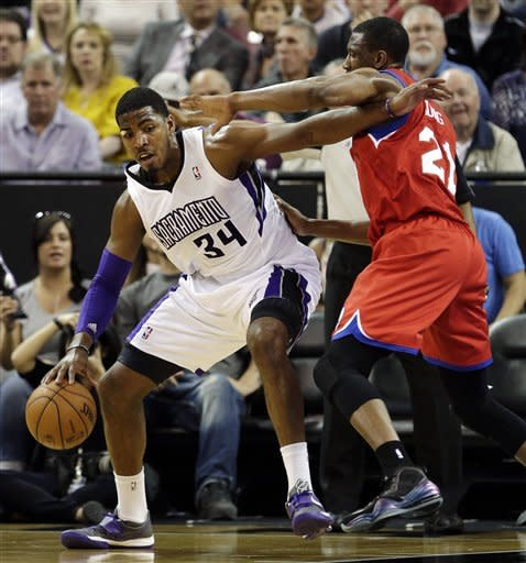 Philadelphia 76ers forward Thaddeus Young, right, defends against Sacramento Kings forward Jason Thompson during the first quarter of an NBA basketball game in Sacramento, Calif., Sunday, March 24, 2013. (AP Photo/Rich Pedroncelli)