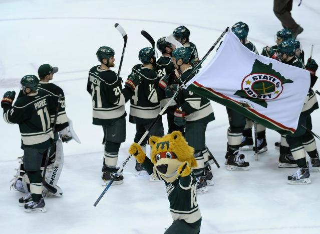 ST PAUL, MN - MAY 9: Nordy, mascot for the Minnesota Wild performs as the Minnesota Wild celebrate a win of Game Four of the Second Round of the 2014 NHL Stanley Cup Playoffs against the Chicago Blackhawks on May 9, 2014 at Xcel Energy Center in St Paul, Minnesota. The Wild defeated the Blackhawks 4-2. (Photo by Hannah Foslien/Getty Images)