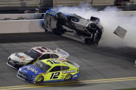 Ryan Newman (6) crashes as Denny Hamlin (11) and Ryan Blaney (12) battle during the NASCAR Daytona 500 auto race Monday, Feb. 17, 2020, at Daytona International Speedway in Daytona Beach, Fla. (AP Photo/Chris O'Meara)