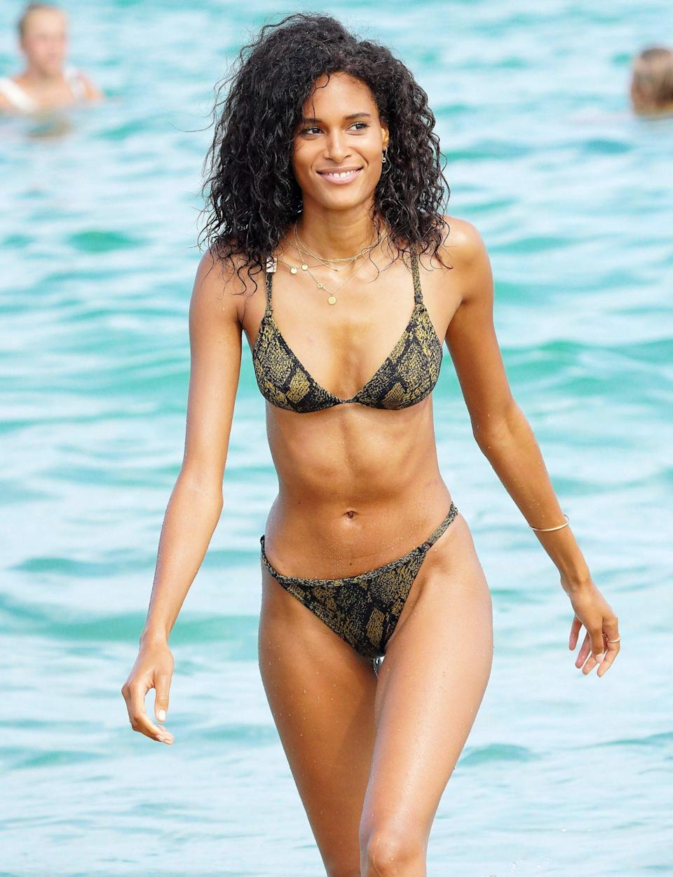 <p>French model Cindy Bruna soaks up some sunshine at celebrity hotspot Club 55 in Saint-Tropez, France, on Wednesday.</p>