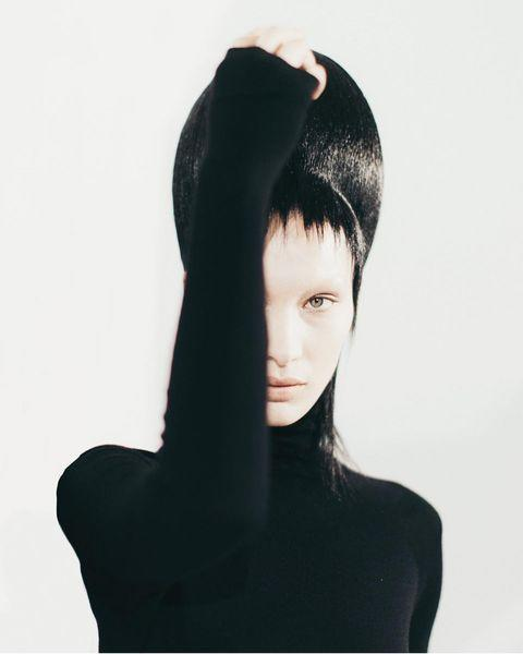 """<p>We're not sure it's actually possible for Bella Hadid to look bad with any hair/eyebrow combo, and the bleached brow and jet black wig (we're getting Winona Ryder Beetlejuice vibes) she donned for Haider Ackermamn's AW20 show went to prove she can pull off any look, ever.</p><p><a href=""""https://www.instagram.com/p/B9M_j3_A9Av/"""" rel=""""nofollow noopener"""" target=""""_blank"""" data-ylk=""""slk:See the original post on Instagram"""" class=""""link rapid-noclick-resp"""">See the original post on Instagram</a></p>"""