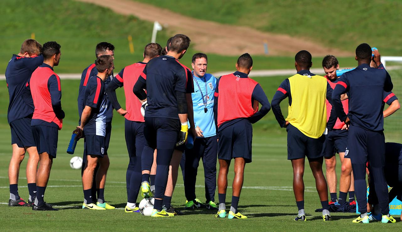 England's U21 coach Steve Holland speaks to the players during a training session at St George's Park, Burton.