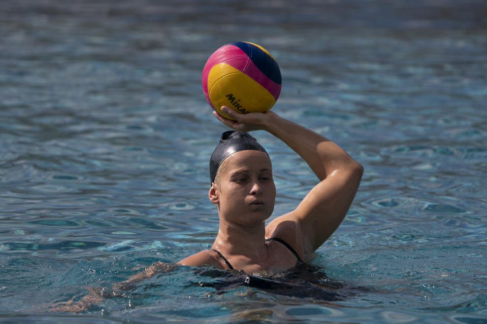 Stephania Haralabidis, a member of the U.S. women's water polo team, trains at MWR Aquatic Training Center on Tuesday, April 27, 2021, in Los Alamitos, Calif. Haralabidis, 26, is among five newcomers on the U.S. squad heading to the Tokyo Games this summer. The 13-player roster was announced Wednesday, June 23, 2021, in Los Angeles.(AP Photo/Jae C. Hong)