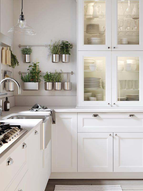 """<p>If you like to display your crockery, glassware, and kitchen accessories, employ some clever <a href=""""https://www.housebeautiful.com/uk/house-beautiful-homes/a35211238/design-ideas-to-declutter-your-kitchen/"""" rel=""""nofollow noopener"""" target=""""_blank"""" data-ylk=""""slk:organisational hacks"""" class=""""link rapid-noclick-resp"""">organisational hacks</a> to keep your white kitchen looking clean and organised. Wall mounted railings make the perfect spot for hanging herbs and planters, and keeping cutting boards or pots and pans close to hand.</p><p>Pictured: <a href=""""https://go.redirectingat.com?id=127X1599956&url=https%3A%2F%2Fwww.ikea.com%2Fgb%2Fen%2Frooms%2Fkitchen%2Faxstad-white-pubf644fa85&sref=https%3A%2F%2Fwww.housebeautiful.com%2Fuk%2Fdecorate%2Fkitchen%2Fg37409102%2Fwhite-kitchen%2F"""" rel=""""nofollow noopener"""" target=""""_blank"""" data-ylk=""""slk:AXSTAD White Kitchen at IKEA"""" class=""""link rapid-noclick-resp"""">AXSTAD White Kitchen at IKEA</a></p>"""