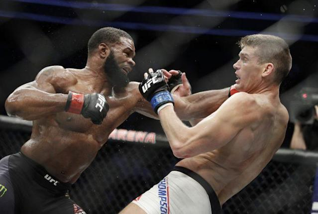 Tyron Woodley lands against Stephen 'Wonderboy' Thompson during Woodley's February victory. (AP)