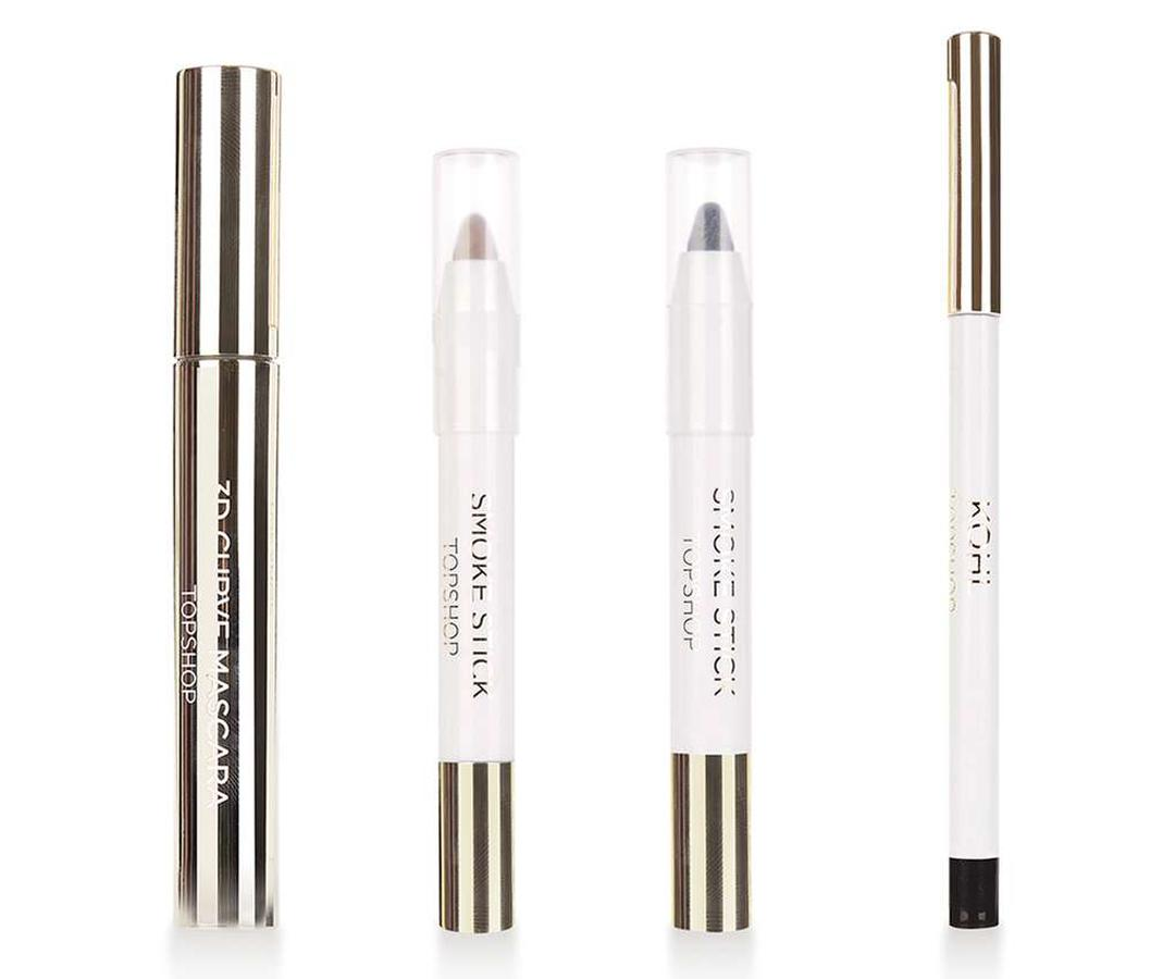 """<p>Small and merry, line, define, smudge, and add a few coats of mascara in all in one go thanks to Topshop's smoky eye ornament kit.</p> <p>$34   <a rel=""""nofollow"""" href='http://click.linksynergy.com/fs-bin/click?id=93xLBvPhAeE&subid=0&offerid=455417.1&type=10&tmpid=8372&RD_PARM1=http%3A%2F%2Fus.topshop.com%2Fen%2Ftsus%2Fproduct%2Fmake-up-70486%2Fthe-gifting-collection-5965904%2Flimited-edition-smokey-eye-kit-6039105%3Fbi%3D0%2526ps%3D20&u1=ISELtravelbeautygifts'>SHOP IT</a></p>"""
