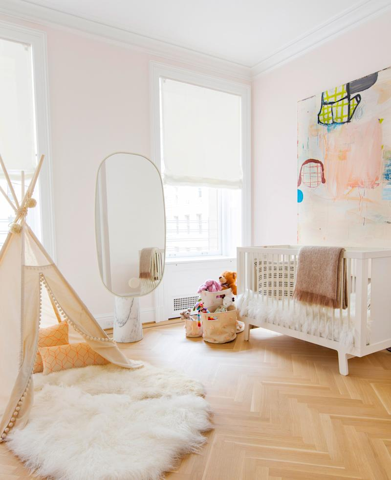 This little girls' room is decorated with a sculptural pedestal mirror from Matter, a buoyant painting by Gary Komarin, and an ultra-plush rug from Nanimarquina.