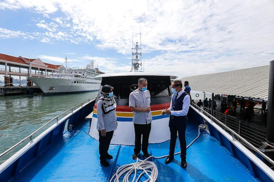 (from left) Penang Port Commission General Manager Monaliza Suhaimi, Penang Port Commission Chairman Datuk Tan Teik Cheng and Penang Port Chairman Datuk Syed Mohamad Aidid Syed Murtaza on the new fast boat, December 28, 2020. — Picture by Sayuti Zainudi