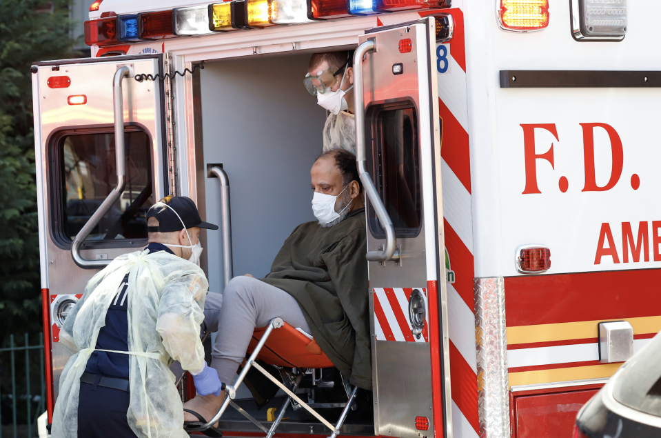 FDNY Emergency Medical Technicians (EMT) lift a patient that was identified to have coronavirus disease (COVID-19) into an ambulance while wearing protective gear, as the outbreak of coronavirus disease (COVID-19) continues, in New York City, New York, U.S., March 24, 2020. (Photo: REUTERS/Stefan Jeremiah)