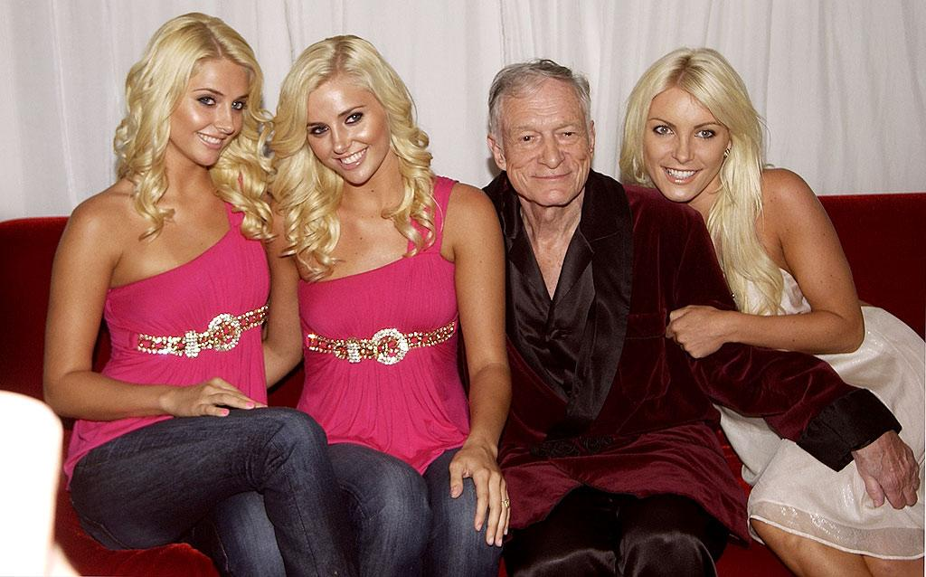 """Hugh Hefner revealed this week how he tells 19-year-old twin girlfriends Karissa and Kristina Shannon apart: Karissa has a mole on her neck. The pair will be featured on the next season of """"The Girls Next Door."""" Mike Guastella/<a href=""""http://www.wireimage.com"""" target=""""new"""">WireImage.com</a> - July 13, 2009"""