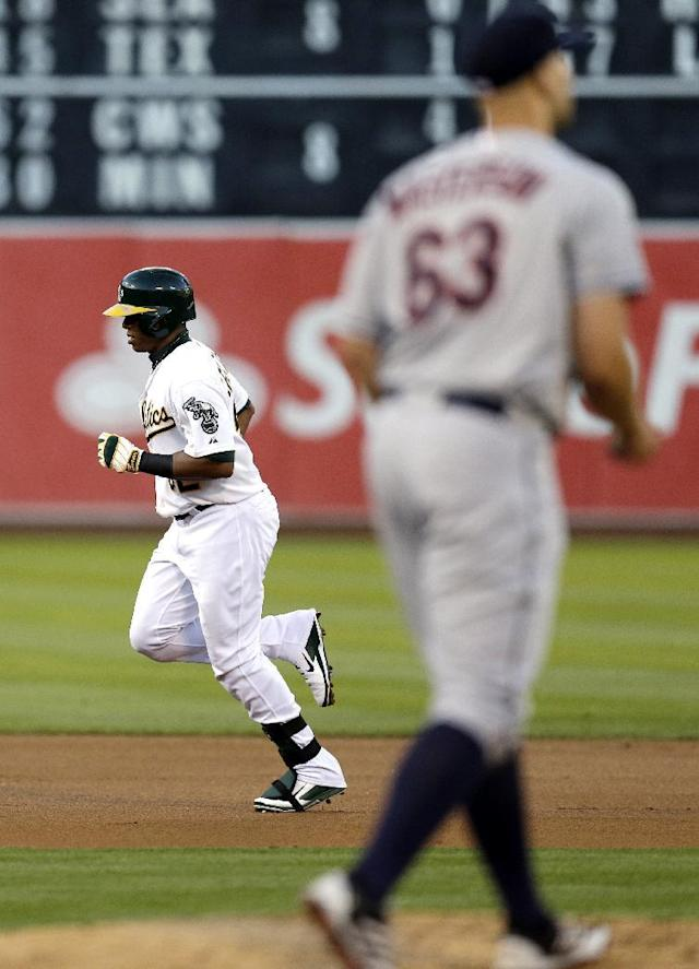 Oakland Athletics' Yoenis Cespedes, left, runs the bases after hitting a two-run home run off Cleveland Indians' Justin Masterson (63) in the first inning of a baseball game, Friday, Aug. 16, 2013, in Oakland, Calif. (AP Photo/Ben Margot)