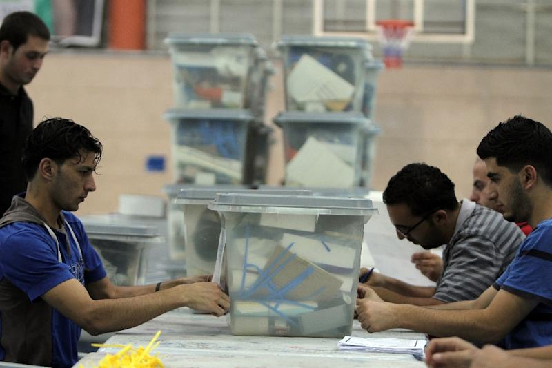 Palestinian officials prepare ballot boxes in Ramallah on October 17, 2012 prior to municipal elections