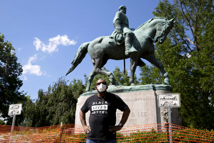 Don Gathers stands in front of a statue depicting Robert E. Lee during a racial justice protest in Charlottesville, Va., on May 30, 2020. (Ryan M. Kelly / AFP via Getty Images file)