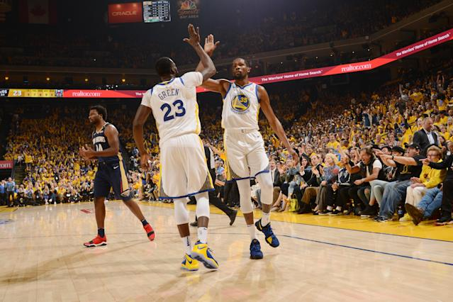 Kevin Durant and Draymond Green led a storm of offense for the Warriors in Game 1. (Getty Images)