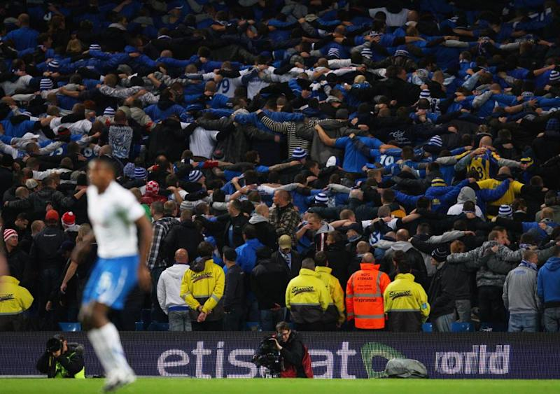 'Let's all do the Poznań' ... Manchester City fans in full flight.