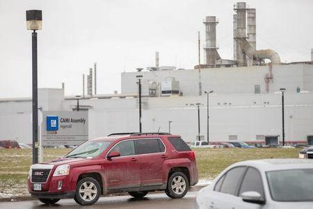 FILE PHOTO: Workers leave the General Motors CAMI car assembly plant where the GMC Terrain and Chevrolet Equinox are built, in Ingersoll