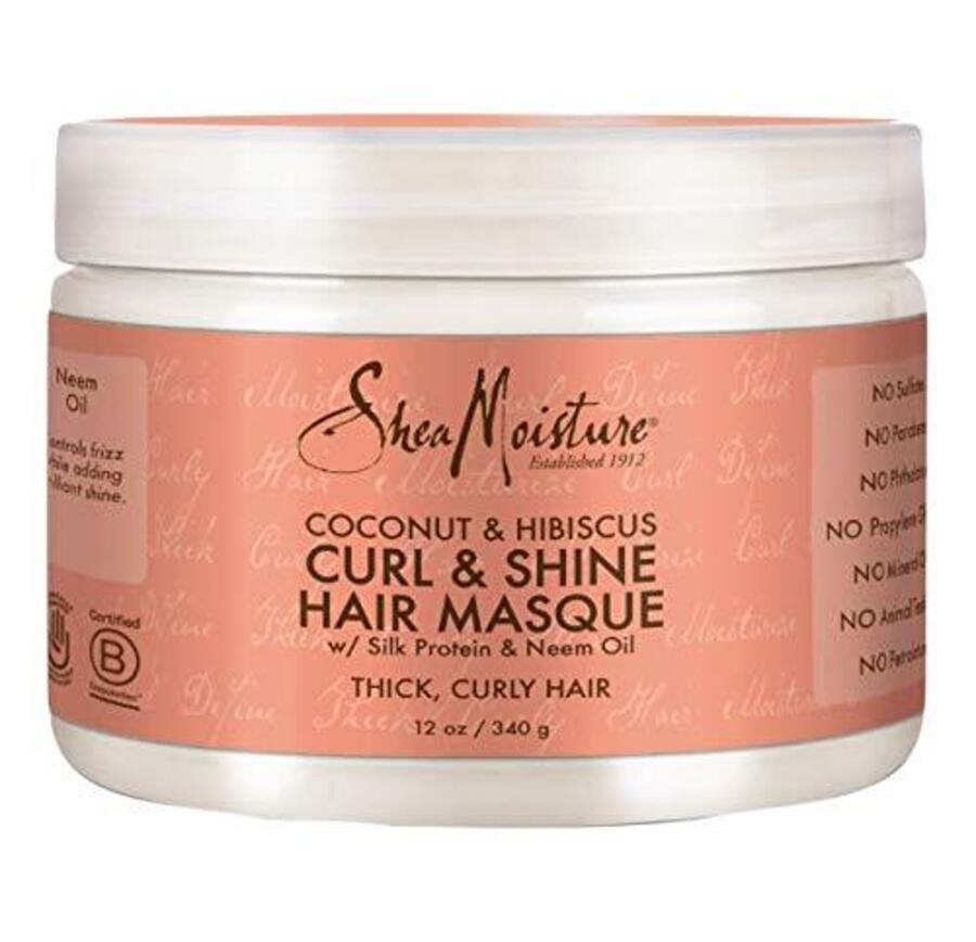 """Saviano recommends SheaMoisture's Coconut & Hibiscus Curl & Shine Hair Masque for its sulfate-, phthalate-, and paraben-free formula, which protects hair from breakage. The treatment is infused with moisturizing <a href=""""https://www.allure.com/topic/coconut-oil?mbid=synd_yahoo_rss"""" rel=""""nofollow noopener"""" target=""""_blank"""" data-ylk=""""slk:coconut oil"""" class=""""link rapid-noclick-resp"""">coconut oil</a> and fatty acid-rich shea butter to smooth frizz."""