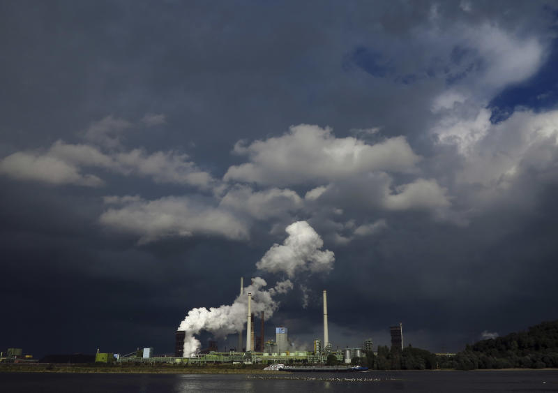 FILE - This Sept. 19, 2012 file photo shows dark clouds filling the sky after a rain shower, behind the ThyssenKrupp Kokerei Schwelgern steel plant on the river Rhine in Duisburg, Germany.  Business optimism in Germany fell for the fifth month in a row, a closely-watched survey showed Monday, Sept. 24, 2012 in another sign that Europe's debt crisis is weighing on the continent's largest economy. (AP Photo/Frank Augstein, File)