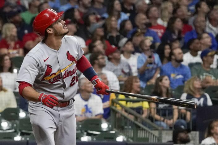 St. Louis Cardinals' Nolan Arenado hits a two-run home run during the first inning of a baseball game against the Milwaukee Brewers Friday, Sept. 3, 2021, in Milwaukee. (AP Photo/Morry Gash)