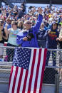 A fan waves during ceremonies before the Indianapolis 500 auto race at Indianapolis Motor Speedway in Indianapolis, Sunday, May 30, 2021. (AP Photo/Darron Cummings)