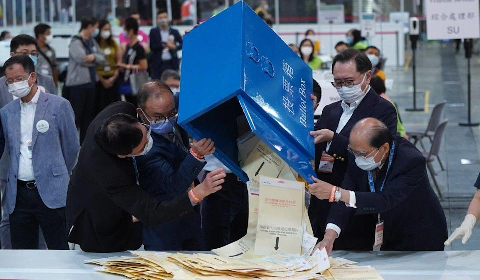 Barnabas Fung (second from right) helps empty the first opened ballot box. Photo: Sam Tsang
