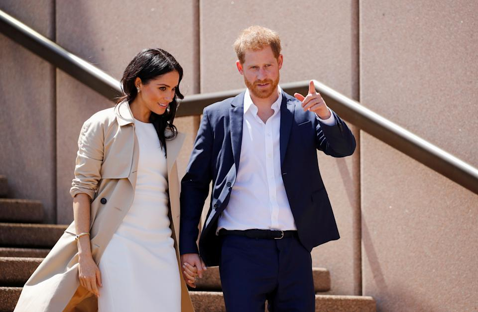 Britain's Prince Harry and wife Meghan, Duchess of Sussex walk during a visit at the Sydney Opera House in Sydney, Australia October 16, 2018. REUTERS/Phil Noble     TPX IMAGES OF THE DAY