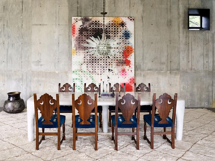 "<div class=""caption""> ""Suzanne wanted the interiors to feel artful yet function for her children,"" says Vaughn Miller. She and McFayden worked with Korean artist Hun-Chung Lee, in partnership with R & Company, to create a minimalist ceramic dining table that offsets the antique chairs, ornate Bakalowits chandelier, and vibrant artwork by Ida Tursic and Wilfried Mille. </div>"