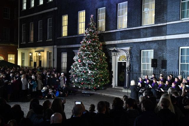 The Military Wives Choir sing carols outside Number 10 (Dominic Lipinski/PA)