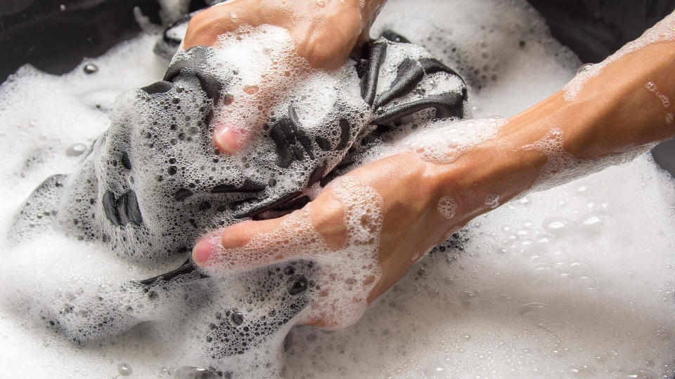 person hand washing laundry