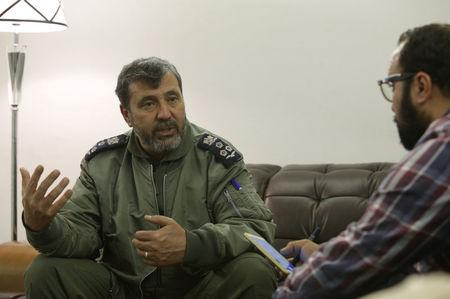 Mohamed Manfour, commander of Benghazi's Benina air base, gestures during an interview with Reuters in Brega