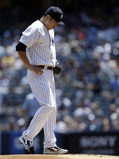 New York Yankees starting pitcher Hiroki Kuroda reacts during the first inning of a baseball game against the Baltimore Orioles, Sunday, July 7, 2013, in New York. (AP Photo/Kathy Willens)