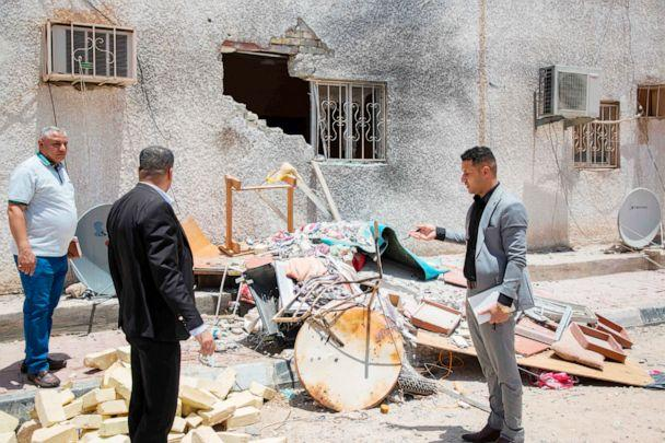 PHOTO:Iraqis inspect the damage at a drilling fascility that was hit by a Katyusha rocket in the Burjesiya area, a key oil-producing region hosting various Iraqi and foreign companies north of the Iraqi city of Basra on June 19, 2019. (Hussein Faleh/AFP/Getty Images)