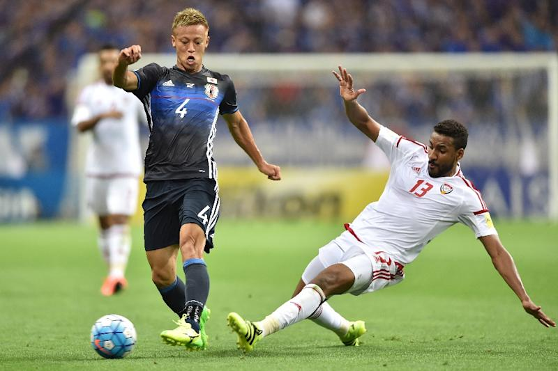 Keisuke Honda (L)blames his own shortcomings for a debate about his future in Japan's national squad