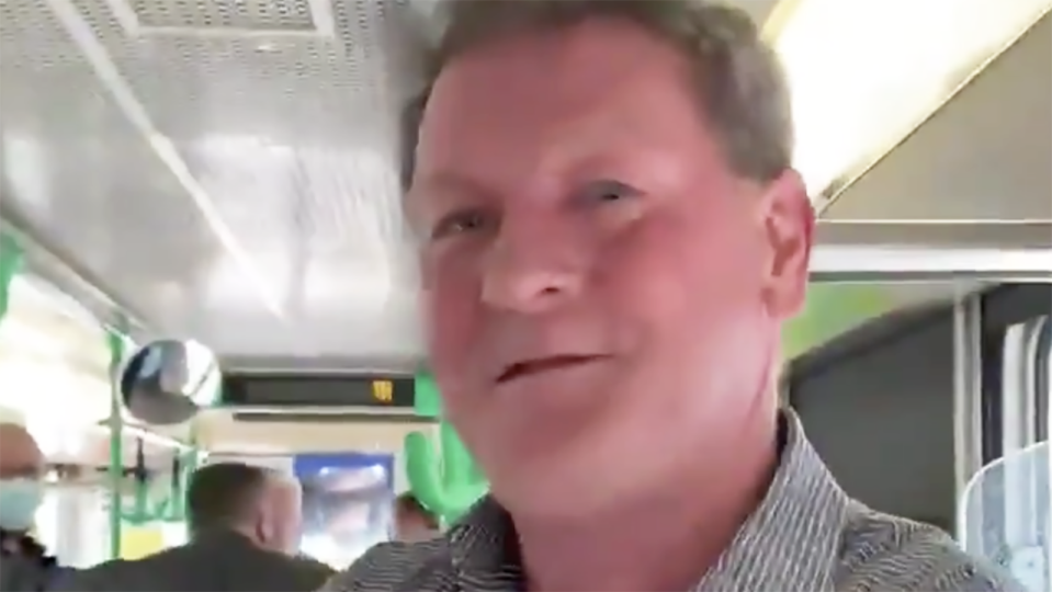 Former AFL player agent Ricky Nixon was filmed appearing to harass a female passenger on a Melbourne tram, who told him to 'go away' after telling him her son had tied two weeks earlier. Picture: Twitter