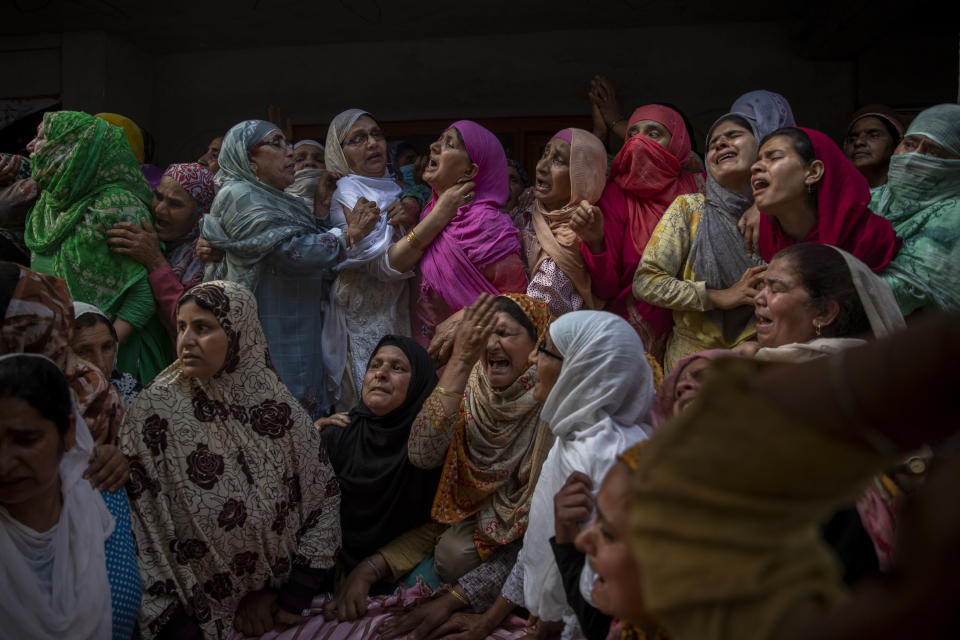 Relatives and neighbors wail during the funeal of Waseem Ahmed, a policeman who was killed in a shootout, on the outskirts of Srinagar, Indian controlled Kashmir, Sunday, June 13, 2021. Two civilians and two police officials were killed in an armed clash in Indian-controlled Kashmir on Saturday, police said, triggering anti-India protests who accused the police of targeting the civilians. (AP Photo/ Dar Yasin)