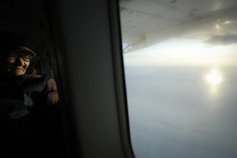 Joe Asuluk flies over his hometown Saturday, Jan. 18, 2020, near Toksook Bay, Alaska. The first Americans to be counted in the 2020 Census starting Tuesday, Jan. 21, live in this Bering Sea coastal village. The Census traditionally begins earlier in Alaska than the rest of the nation because frozen ground allows easier access for Census workers, and rural Alaska will scatter with the spring thaw to traditional hunting and fishing grounds. (AP Photo/Gregory Bull)