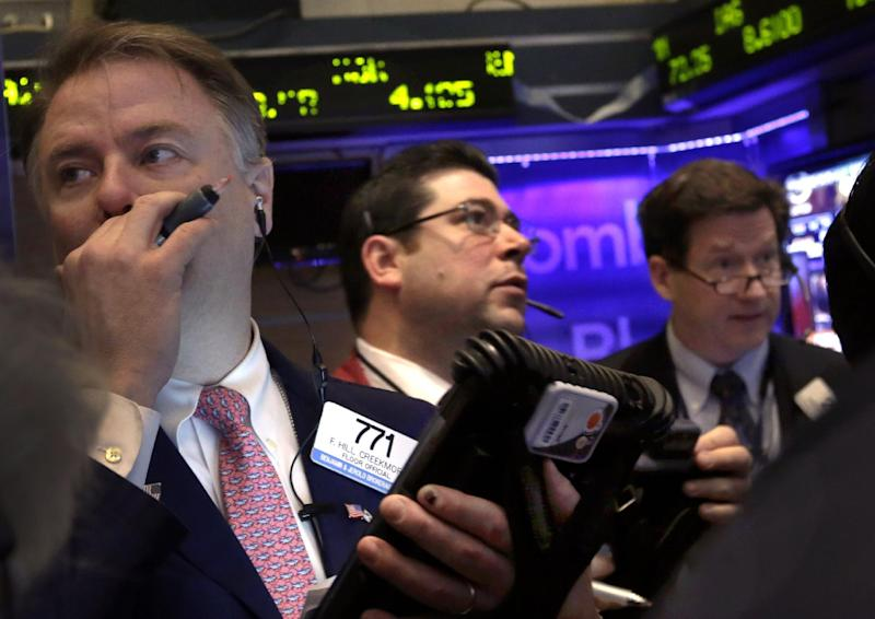 """Traders work on the floor of the New York Stock Exchange, Wednesday, Jan. 30, 2013. The Federal Reserve says growth """"paused"""" in recent months and reaffirmed its commitment to boost a sluggish U.S. economy by keeping borrowing cheap for the foreseeable future. (AP Photo/Richard Drew)"""