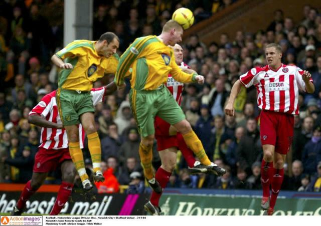 FILE PHOTO: Norwich's Iwan Roberts heads the ball