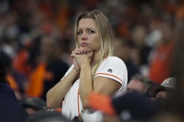 A fan watches during the ninth inning of Game 6 of the baseball World Series between the Houston Astros and the Washington Nationals Tuesday, Oct. 29, 2019, in Houston. (AP Photo/David J. Phillip)