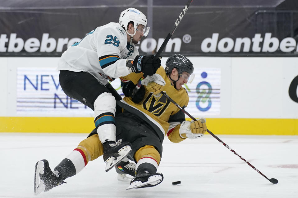 San Jose Sharks right wing Kurtis Gabriel (29) knocks Vegas Golden Knights left wing Tomas Nosek (92) to the ice during the third period of an NHL hockey game Wednesday, March 17, 2021, in Las Vegas. (AP Photo/John Locher)
