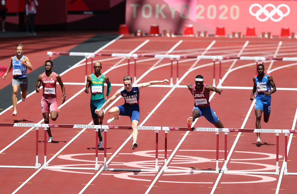 TOKYO, Japan - August 03: Norway's Carsten Warholm and Roy Benjamin of the United States compete in the men's 400m hurdles final on the eleventh day of the Tokyo 2020 Olympic Games on August 03, 2021 at the Olympic Stadium in Tokyo.  Japan (Photo by Christian Peterson / Getty Images)