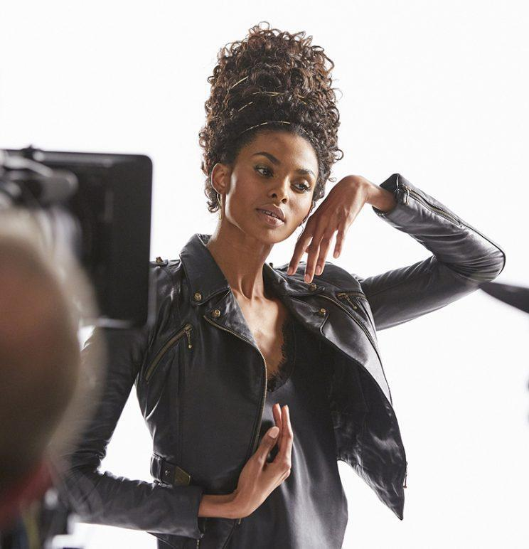 A model poses with an adorned textured updo during the taping of Pantene's Gold Series commercial. (Photo: courtesy of Pantene)
