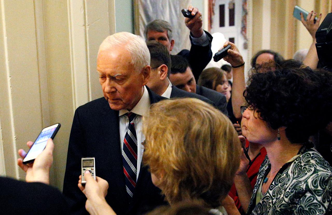 Senate Finance Chairman Orrin Hatch (R-UT) is surrounded by reporters as he departs a meeting where the Senate Republican draft bill on healthcare was unveiled in the U.S. Capitol in Washington, June 22, 2017.  REUTERS/Kevin Lamarque
