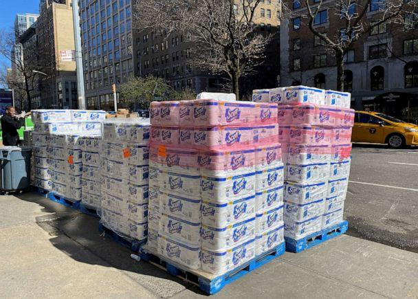 PHOTO: Pallets of toilet paper fill the sidewalk in front of grocer Fairway in Manhattan after panicky shoppers depleted shelves, amid fears of the global growth of coronavirus cases, in Manhattan, New York, March 15, 2020. (Anna Driver/Reuters)