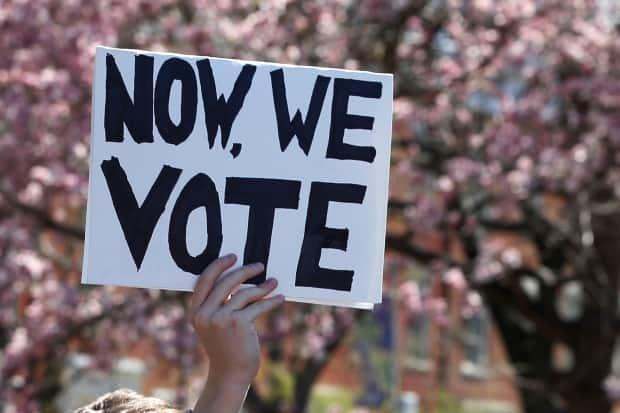 The motion to support lowering the voting age passed almost unanimously, and several councillors voiced their support. (Brendan McDermid/Reuters - image credit)