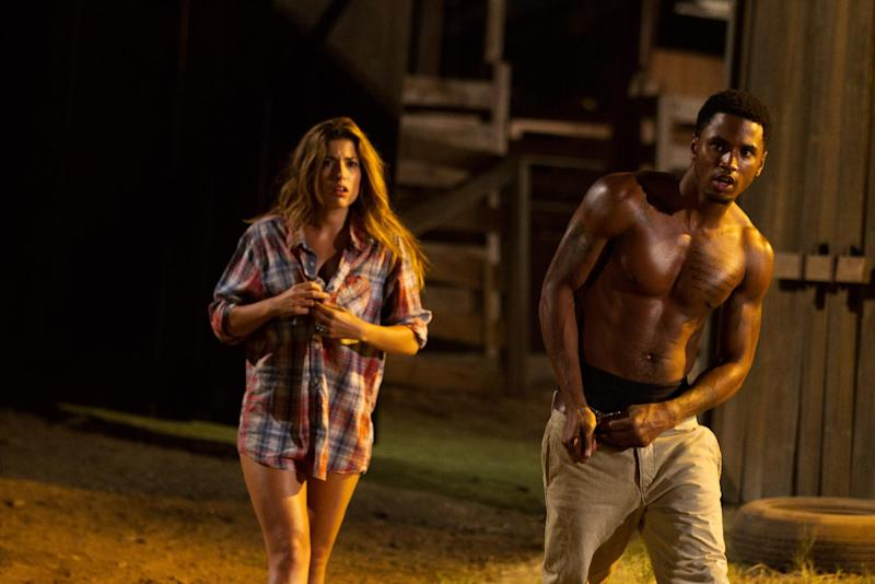 "This undated publicity film image from Lionsgate shows Tania Raymondei, left, as Nikki, and Tremaine ""Trey Songz"" Neverson, as Ryan, in a scene from ""Texas Chainsaw 3-D,"" releasing in theaters on Friday, January 4, 2013. (AP Photo/Lionsgate, Justin Lubin)"