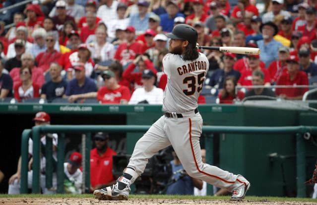 San Francisco Giants' Brandon Crawford watches his two-run homer during the fourth inning of a baseball game against the Washington Nationals at Nationals Park, Sunday, June 10, 2018, in Washington. (AP Photo/Alex Brandon)