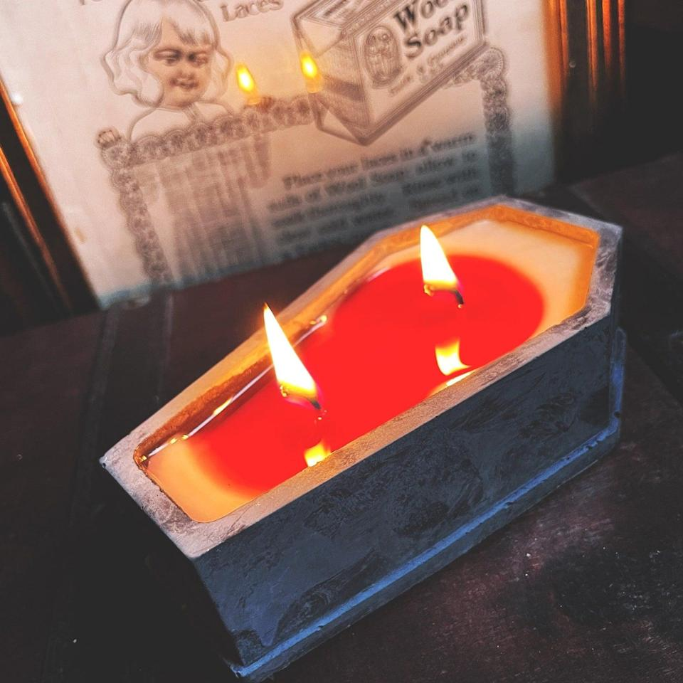 <p>We love a candle that doubles as a statement piece. This moon witch lavender-scented <span>Bleeding Coffin Candle</span> ($17) is handmade and hand-poured with red dye for a bloody effect. </p>